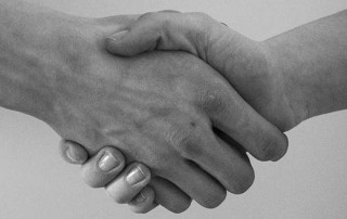 Compensation Culture or Repairing Wrongs - Hands shaking